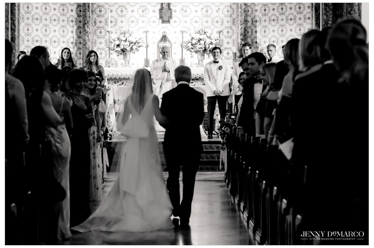 Bride is walked down the aisle by her dad.