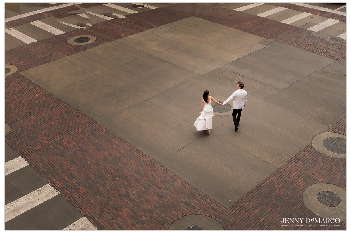The couple walks along downtown Austin's streets.