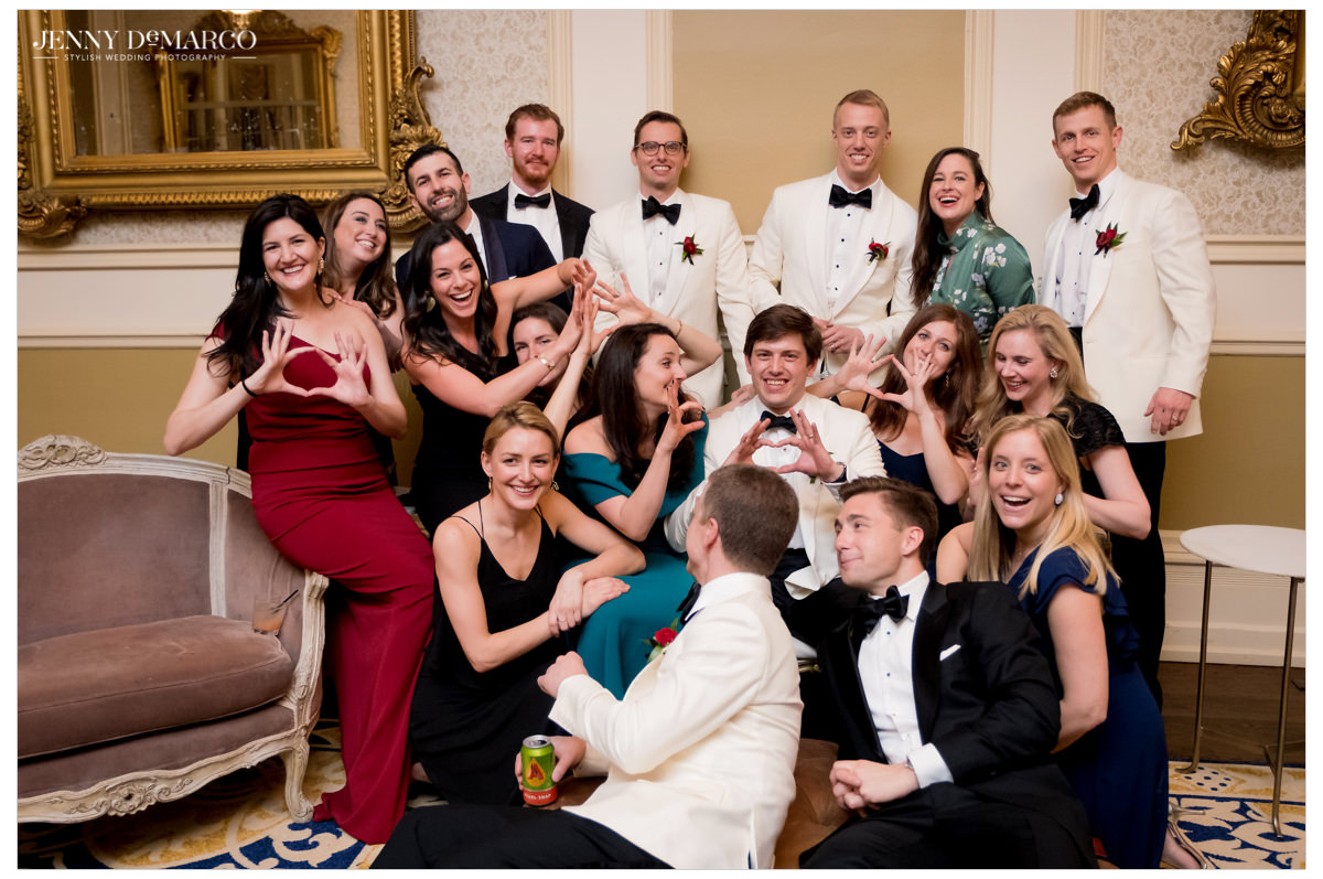 Groom poses with sorority and fraternity friends.