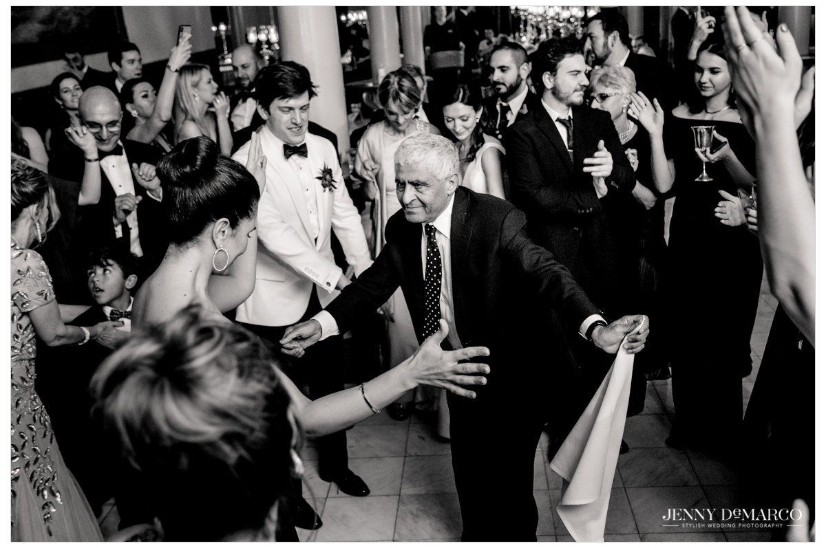 Guests dance at the reception.