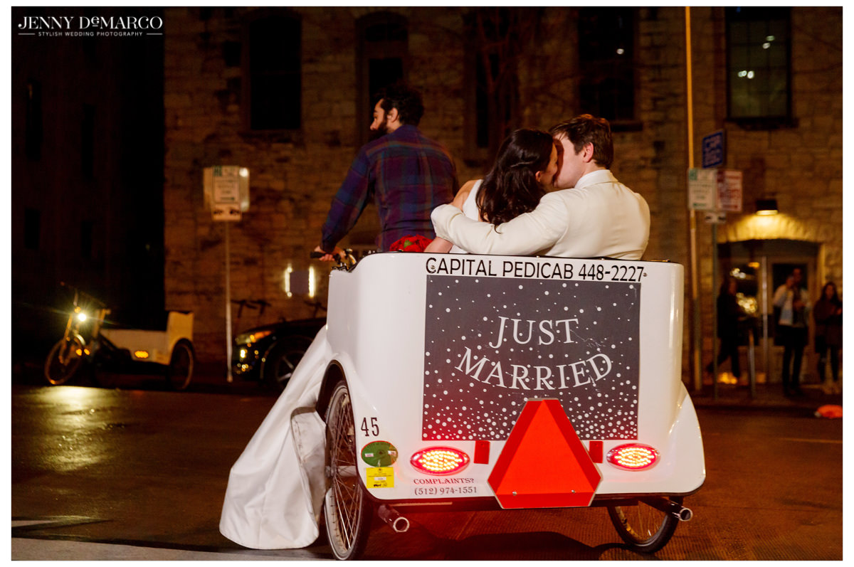 "The couple leaves the reception in a ""Just Married"" pedicab."