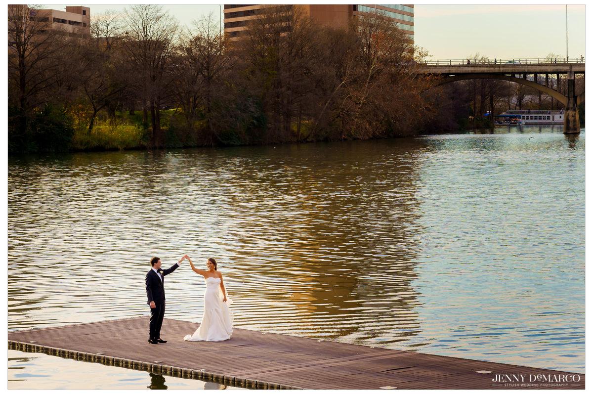 Groom twirls his bride on Town Lake.