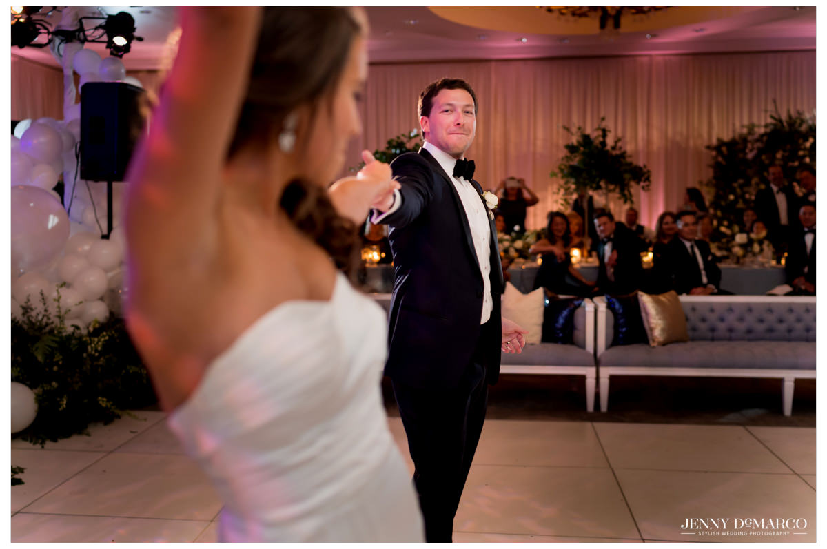 Groom twirls out his bride.