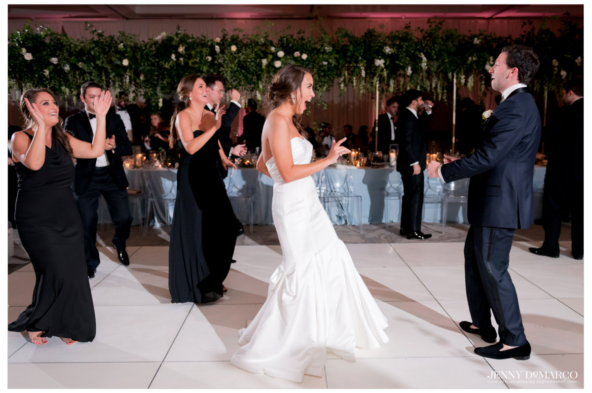 Guests dance with the married couple.