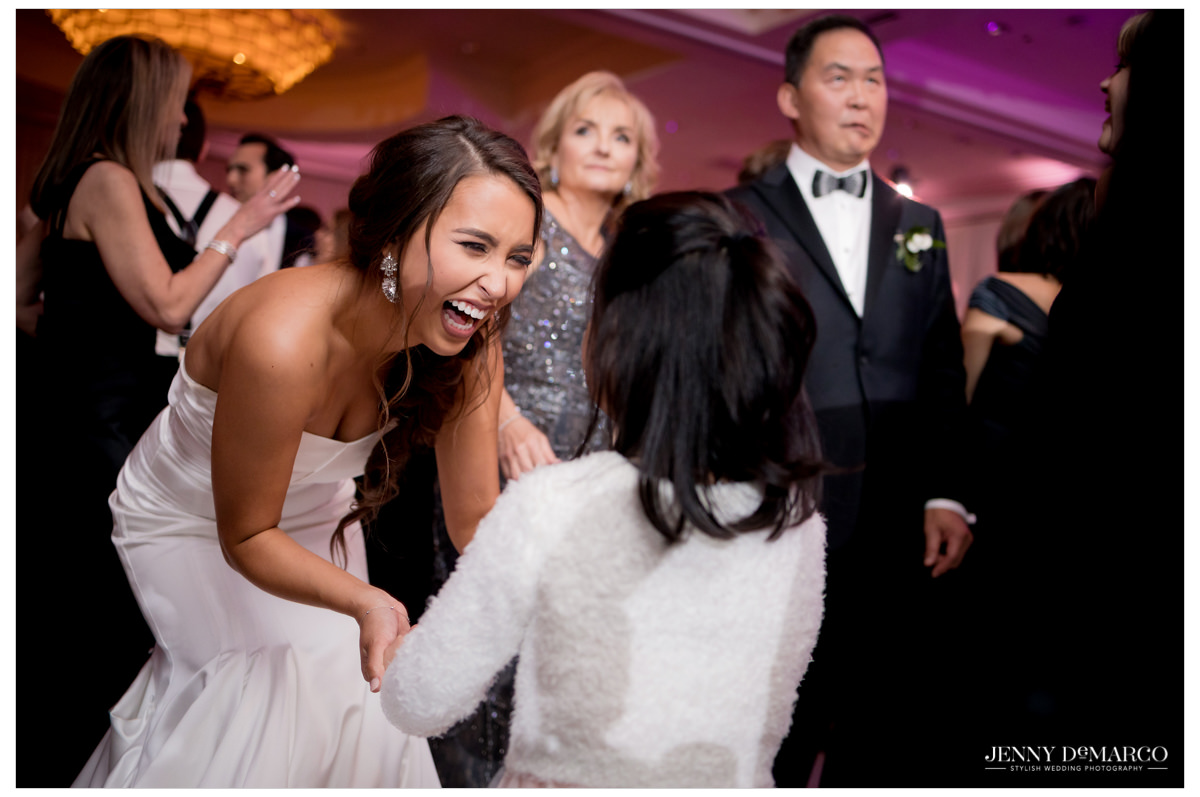Bride dances with a little girl.