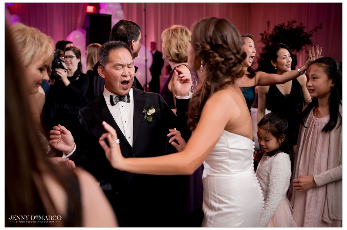 Bride dances with her father.