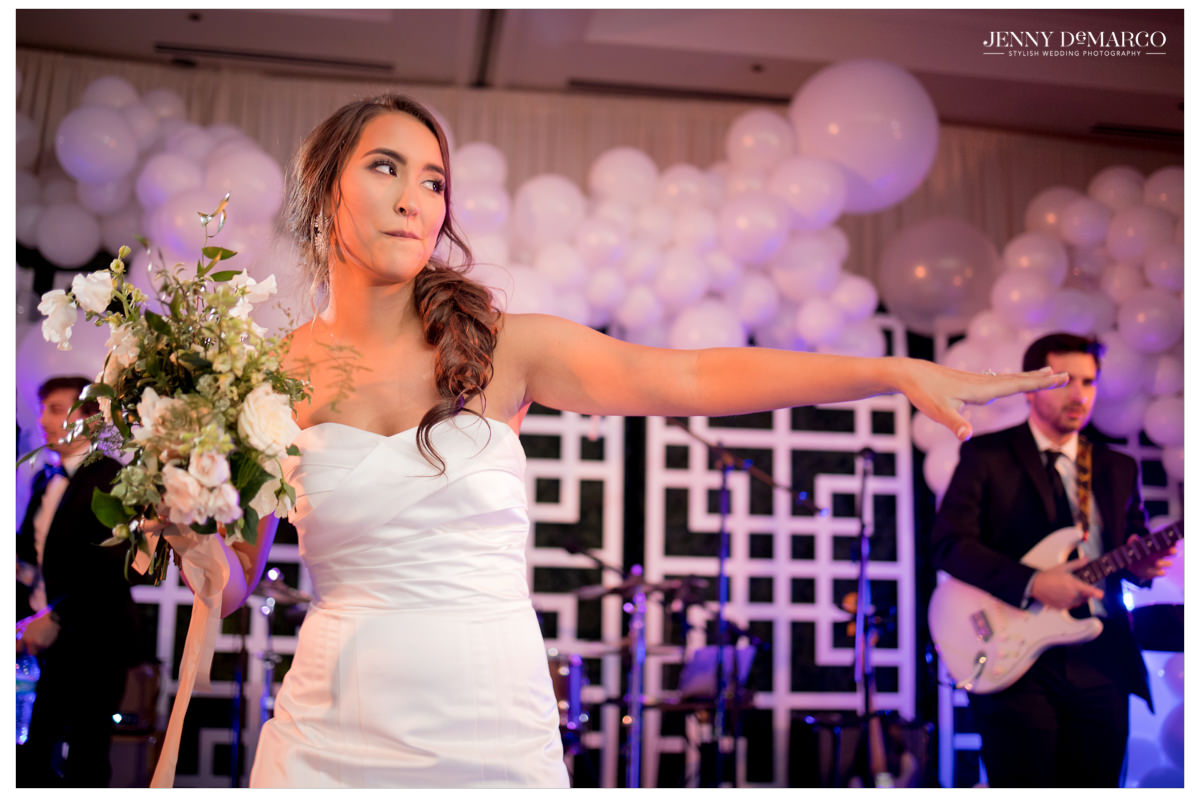 Bride gets ready for bouquet toss.