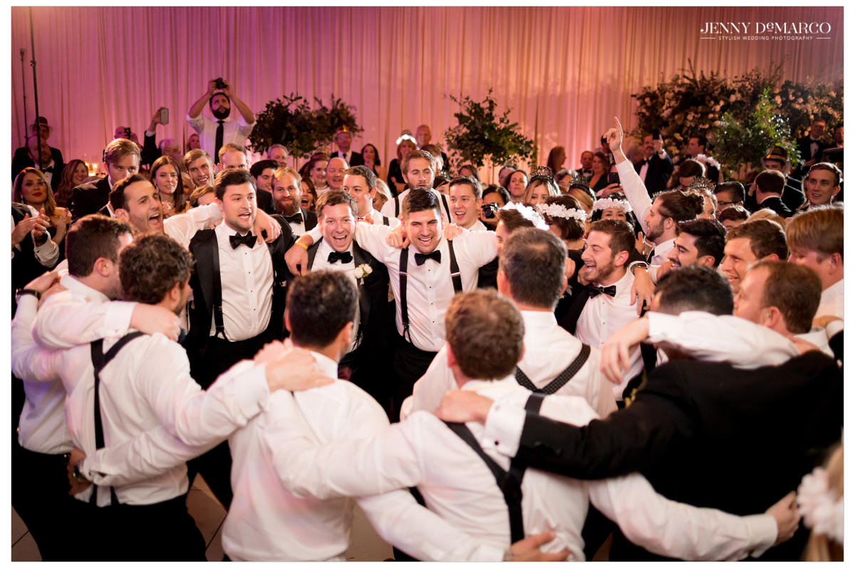 All the men gather on the dance floor.