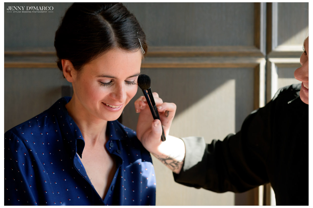 Bride getting her makeup done.