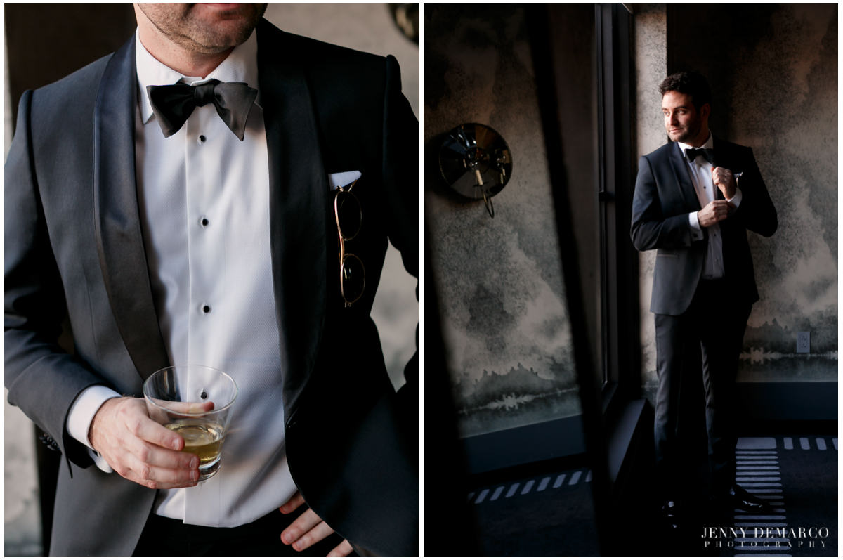 Groom poses for photos in his black tux.