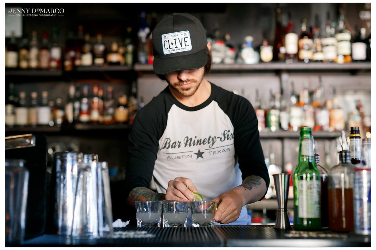 Bartender gets drinks ready for the groomsmen.