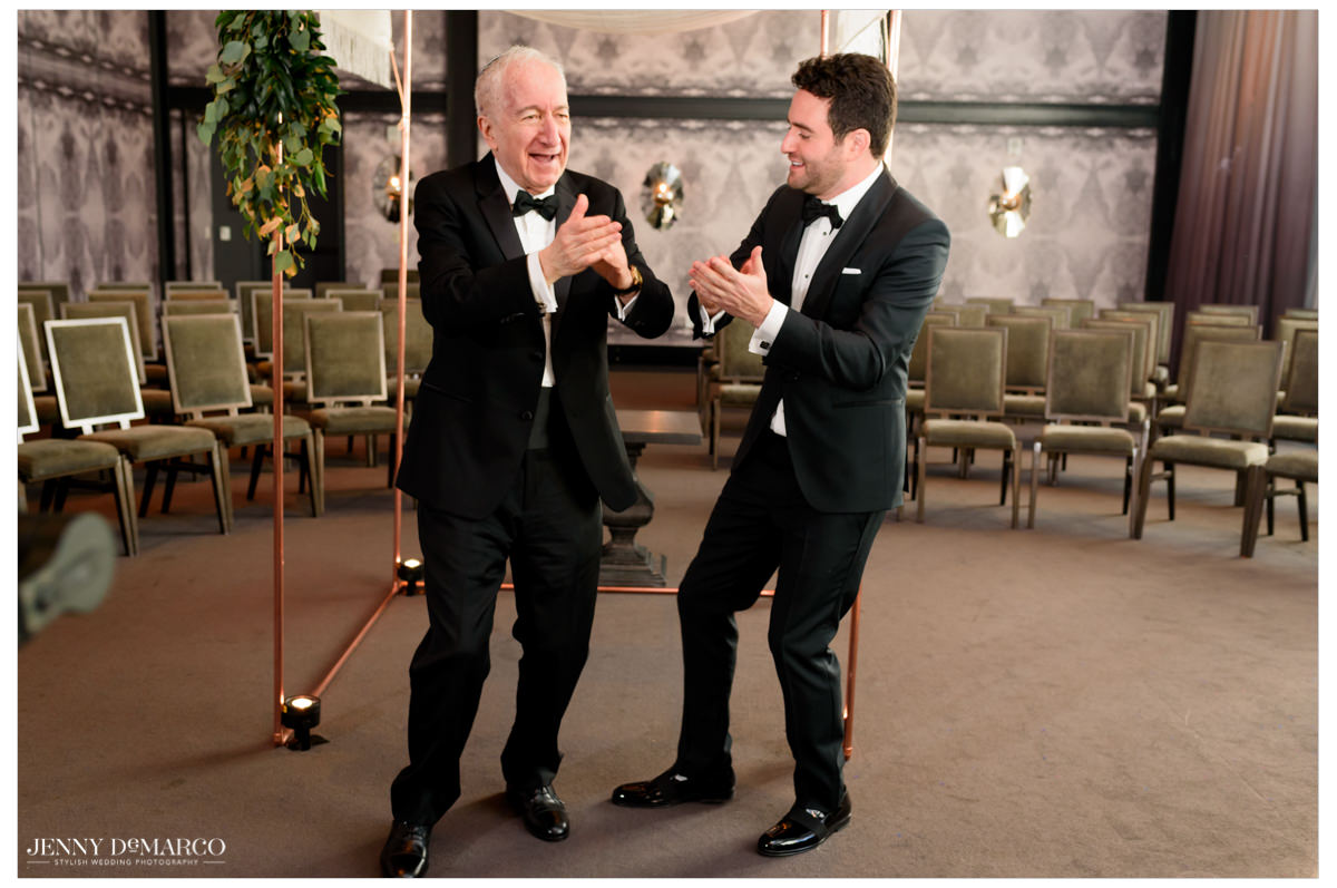 Groom dances with the father.