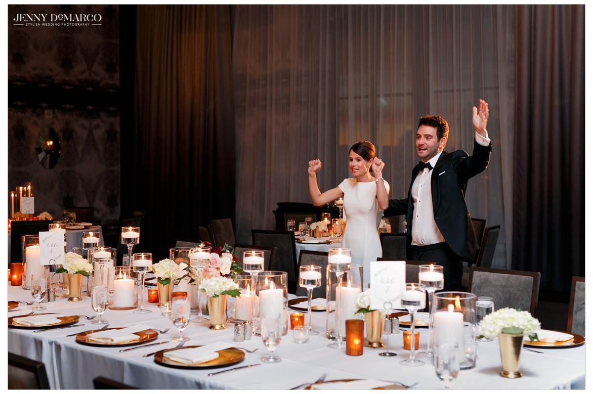 The couple cheers at their decor.