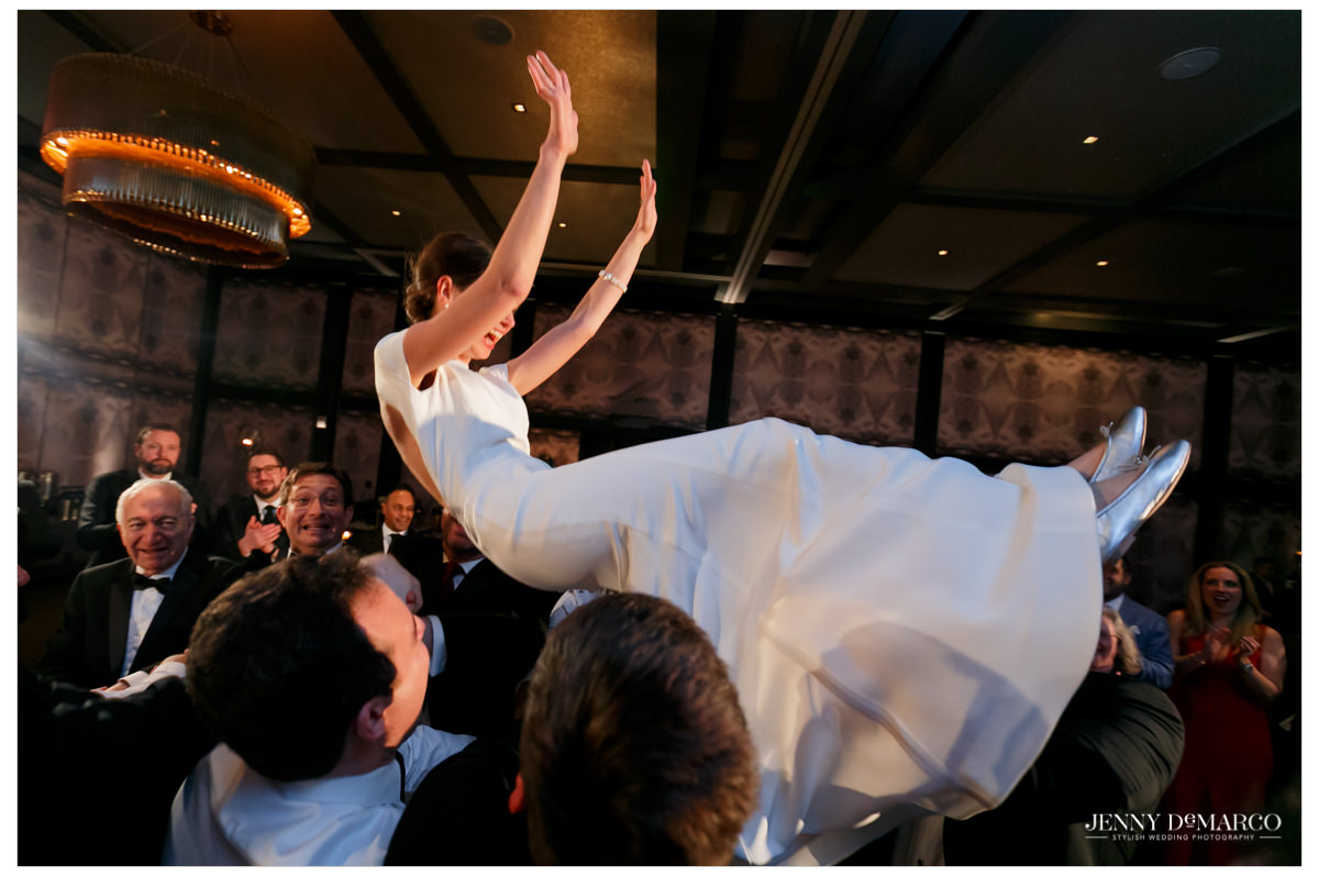 Bride is raised in the air.