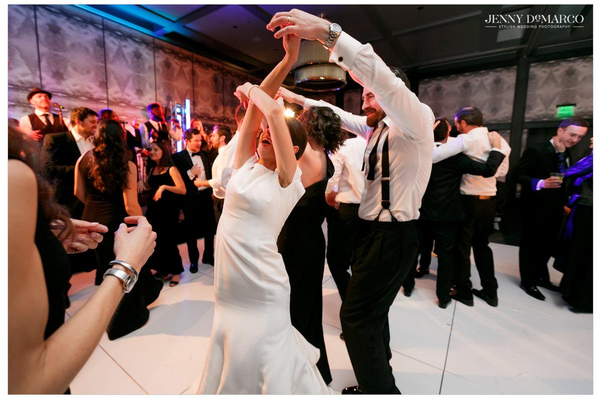 Groom twirls his bride.