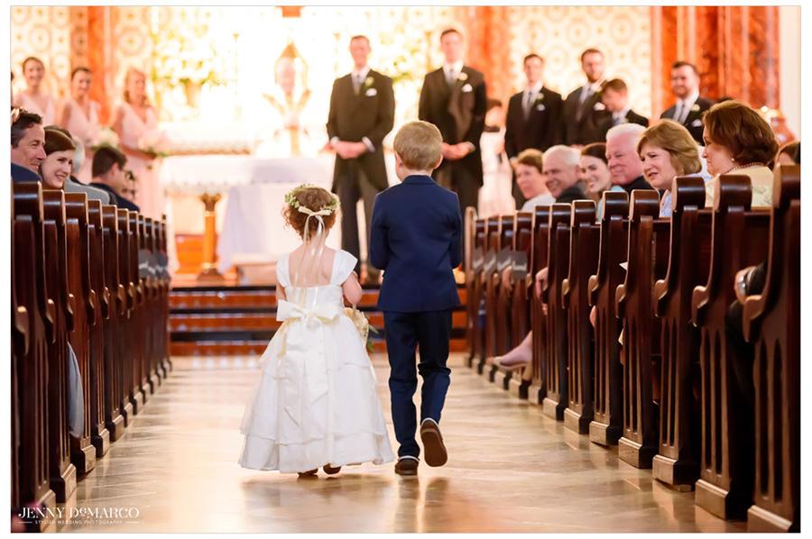 Flower girl and ring bearer walking down the aisle