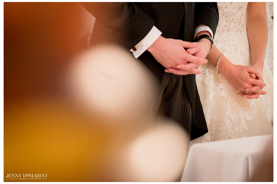 Bride and grooms hands crossed
