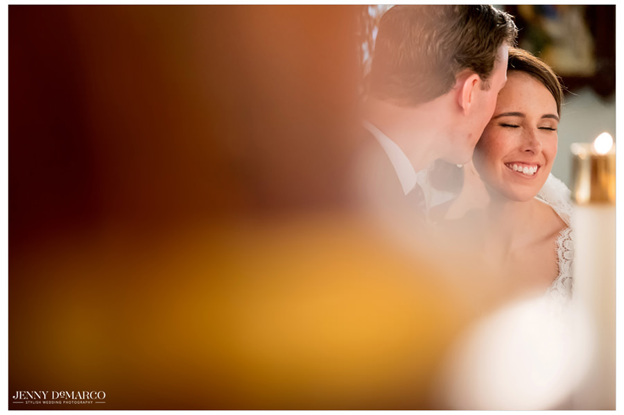 Bride and groom sharing an intimate moment during the ceremony