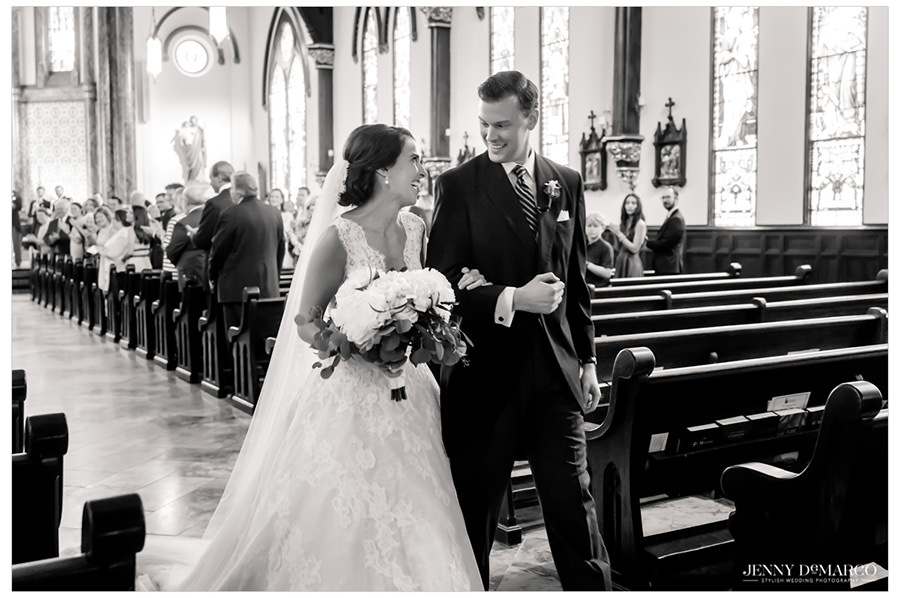 Bride and groom walking down the aisle as a married couple
