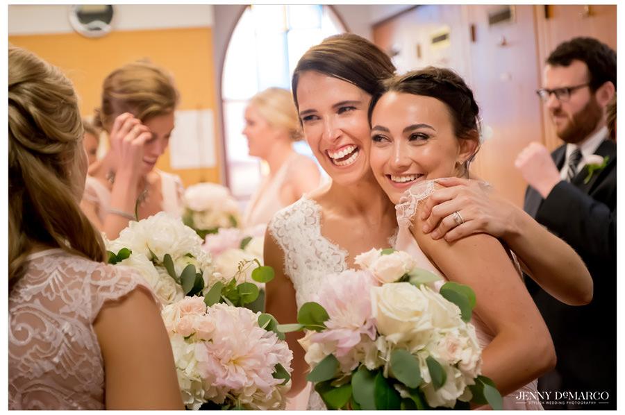 Bride hugging her bridesmaid