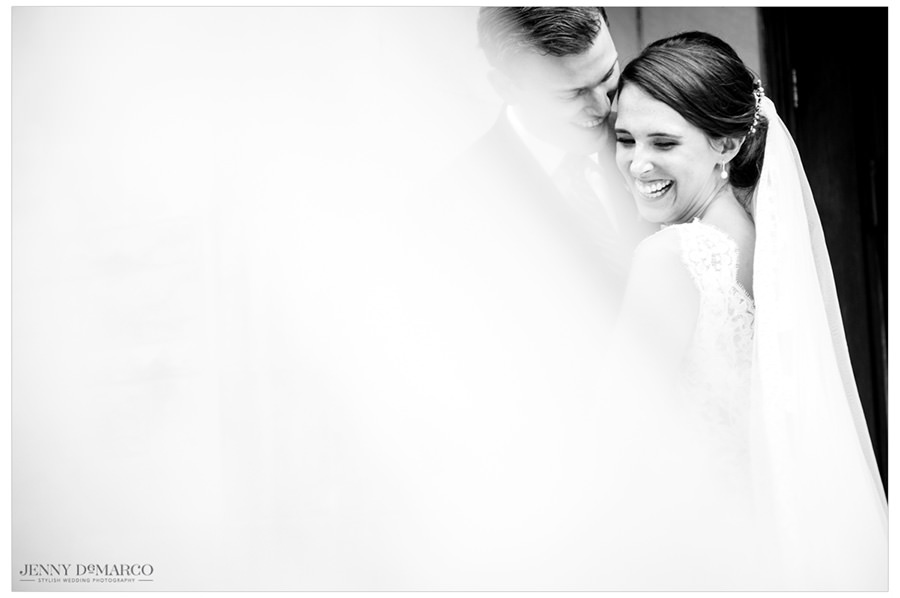 Bride and Groom smiling and sharing an intimate moment