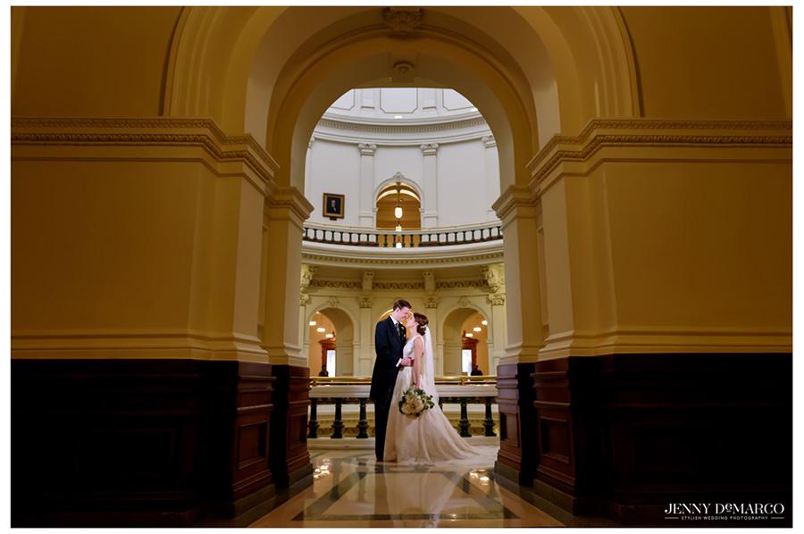 Bride and groom kissing in Bob Bullock Museum