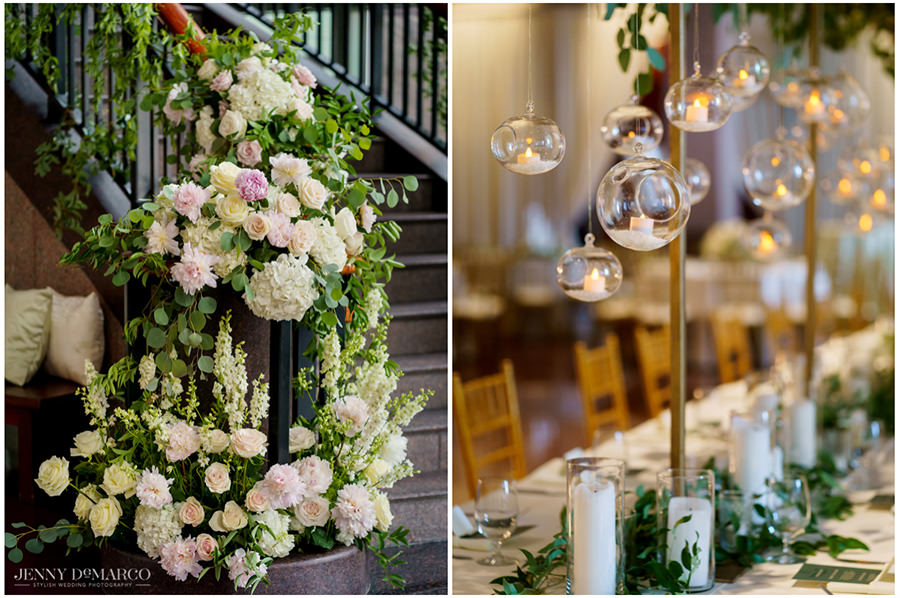 Greenery and floral detail and hanging candles at the reception