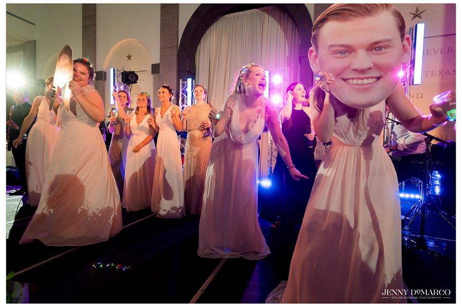 Bridesmaids dancing with fatheads of the bride and groom