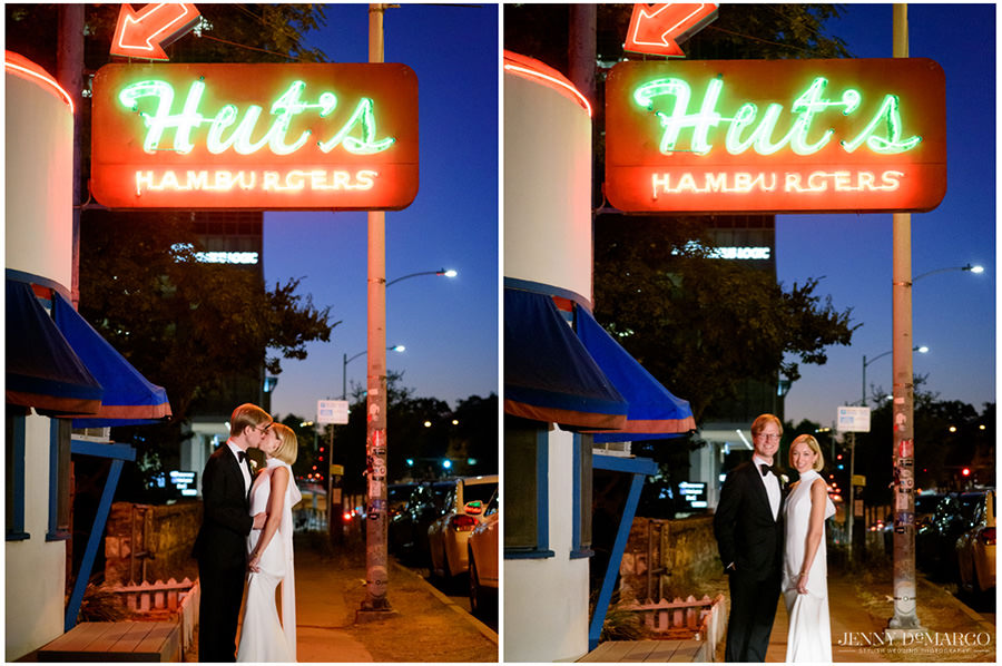 Bride and groom under the glowing sign of Hut's Hamburgers restaurant in downtown Austin.