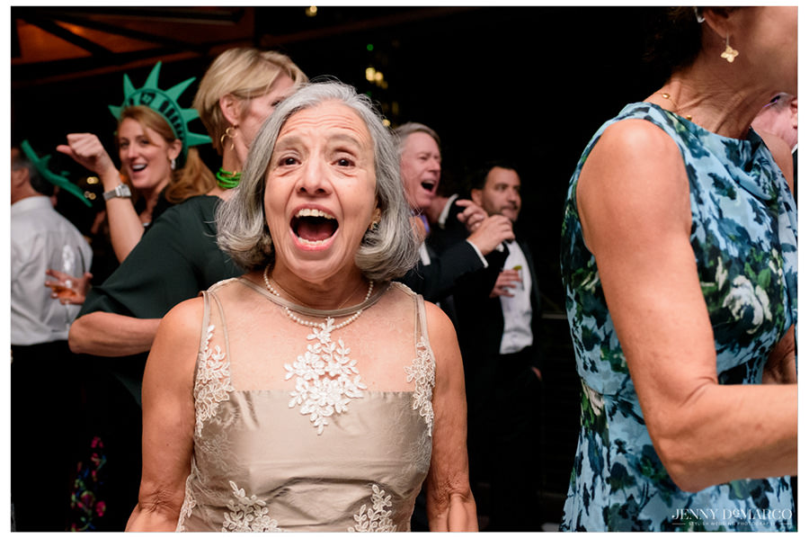 Woman smiles at the camera in excitement during the reception party.