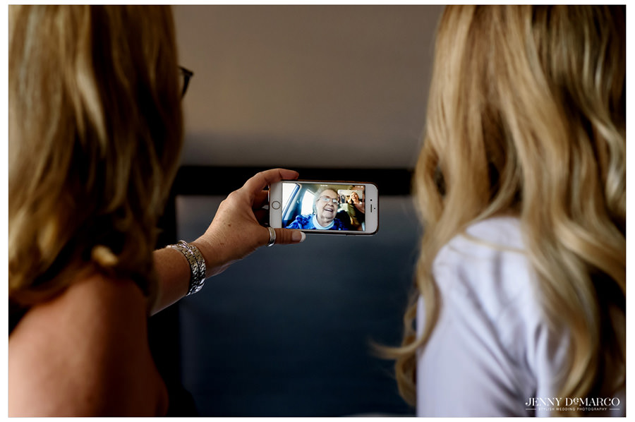Bride and mother of the bride FaceTiming Bride's grandmother