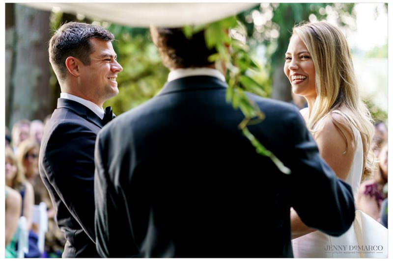 bride and groom laughing at the wedding officiant