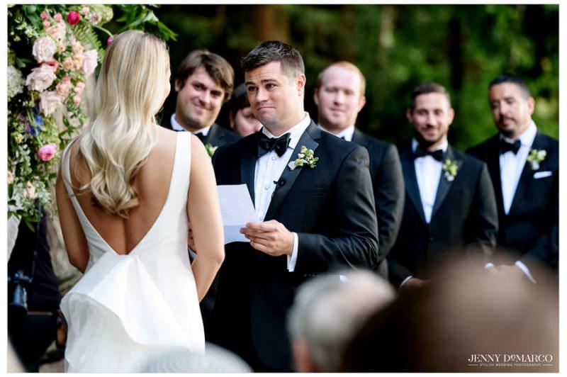 groom reading his wedding vows to bride