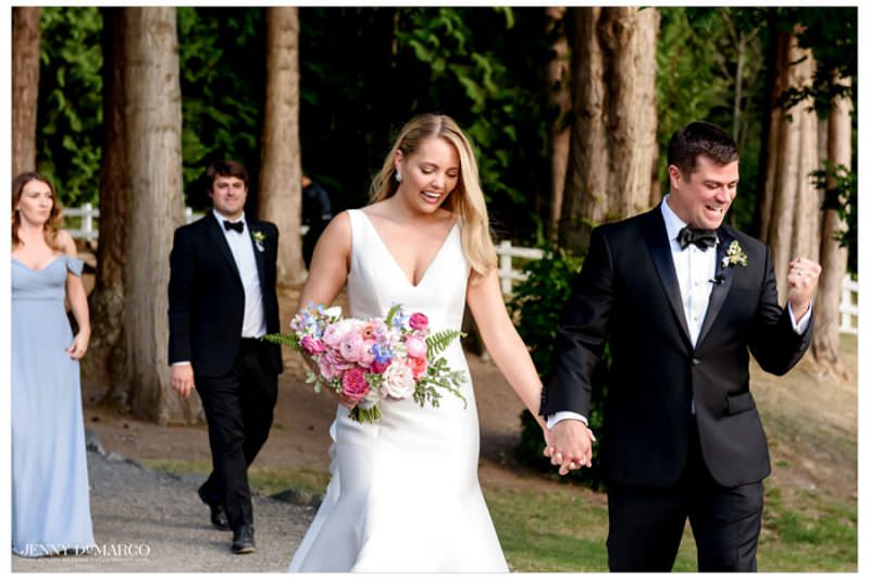 groom celebrating as him and his bride exit the wedding ceremony