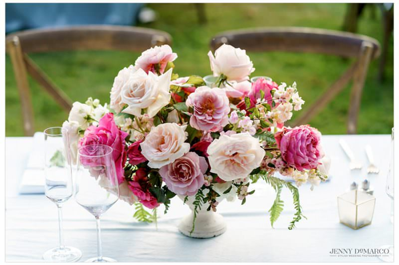 roses and floral centerpiece at wedding reception table