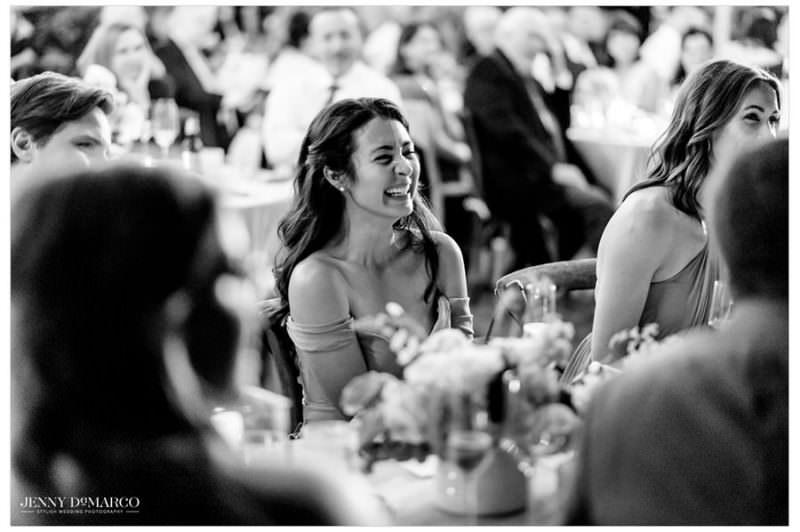 bridesmaid laughing at the wedding reception