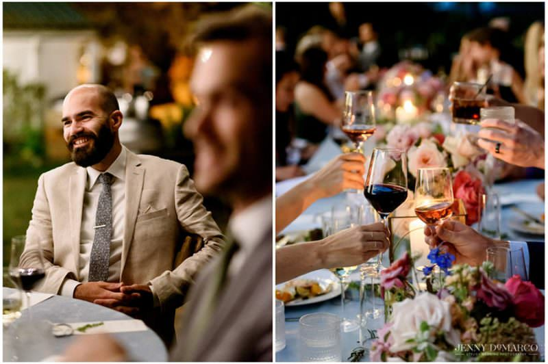 guests raising their wine glasses and enjoying the speeches at the wedding reception