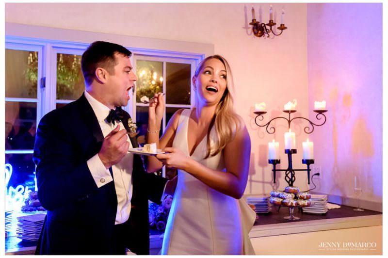 bride feeding the groom their wedding cake