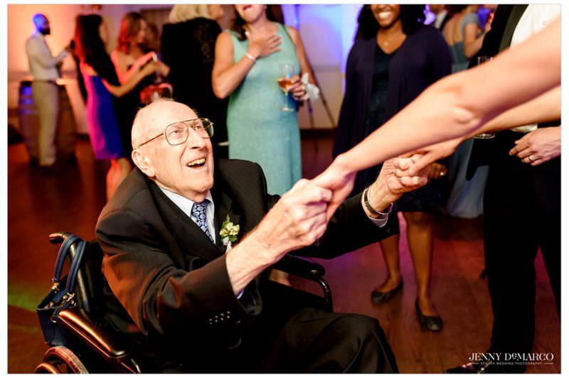 grandfather enjoying the wedding reception