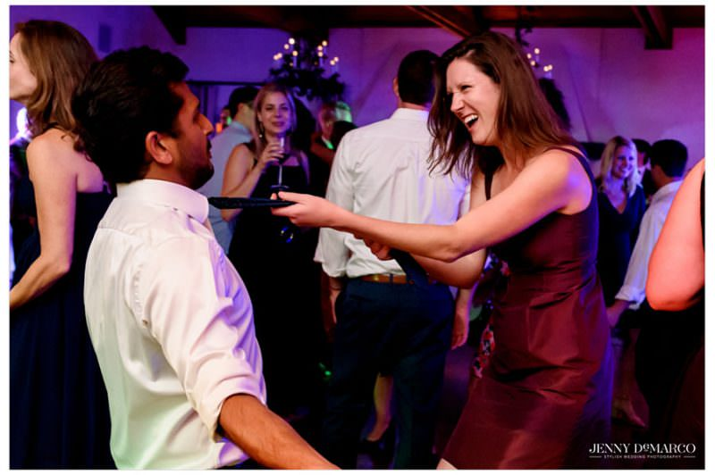 guests dancing and pulling ties at the wedding reception
