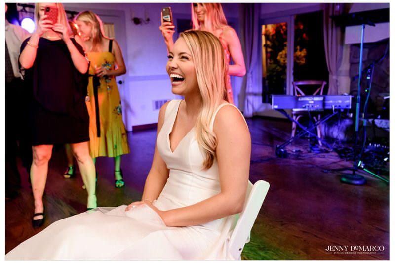 bride smiling and enjoying the wedding reception