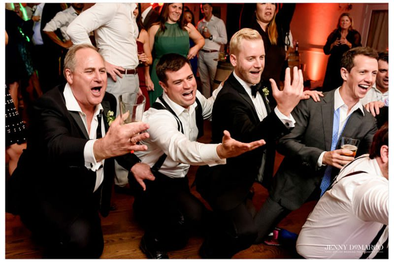 groomsmen singing to the bride