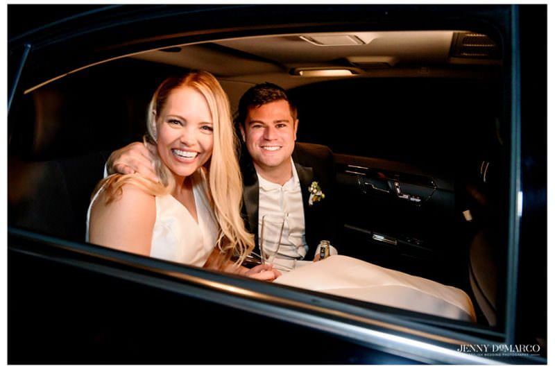 bride and groom in the exit car leaving to go on their honeymoon