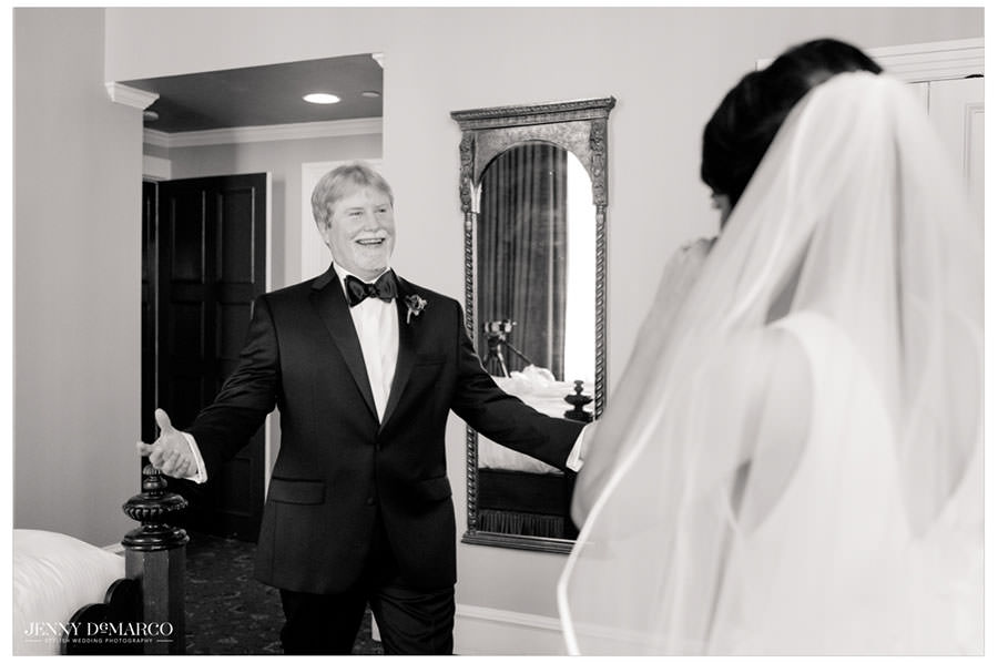 Father of the bride seeing her in her wedding dress