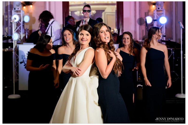 bride and her sister/maid of honor dancing