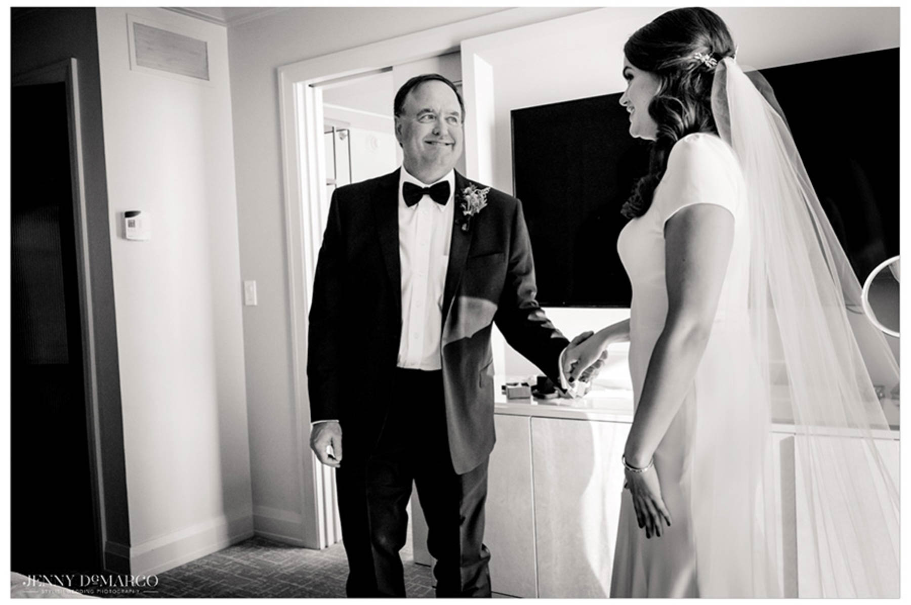 father of bride takes first look at bride in her dress
