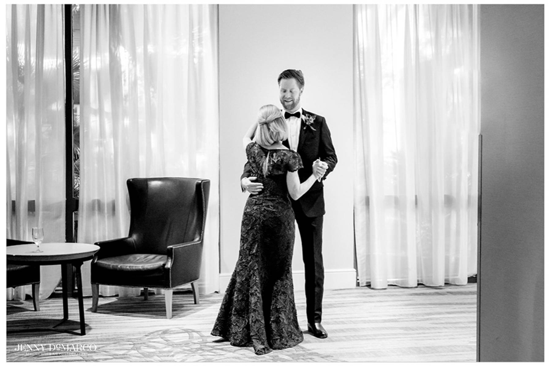 groom dances with his mother before the ceremony in the hotel