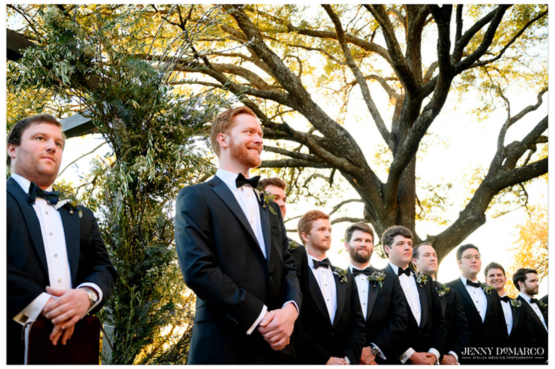 groom and groomsmen wait in excitement during the ceremony