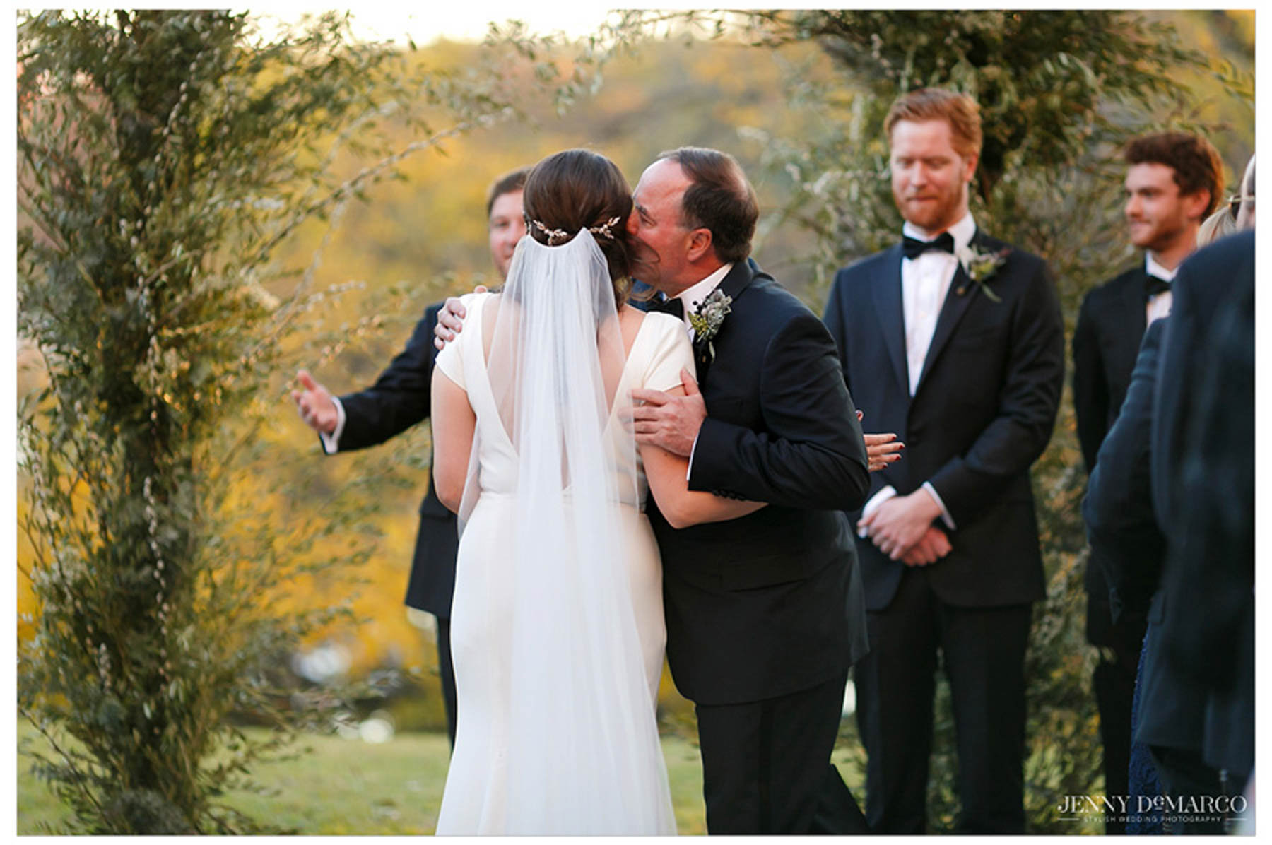 father kisses bride at altar before handing her off