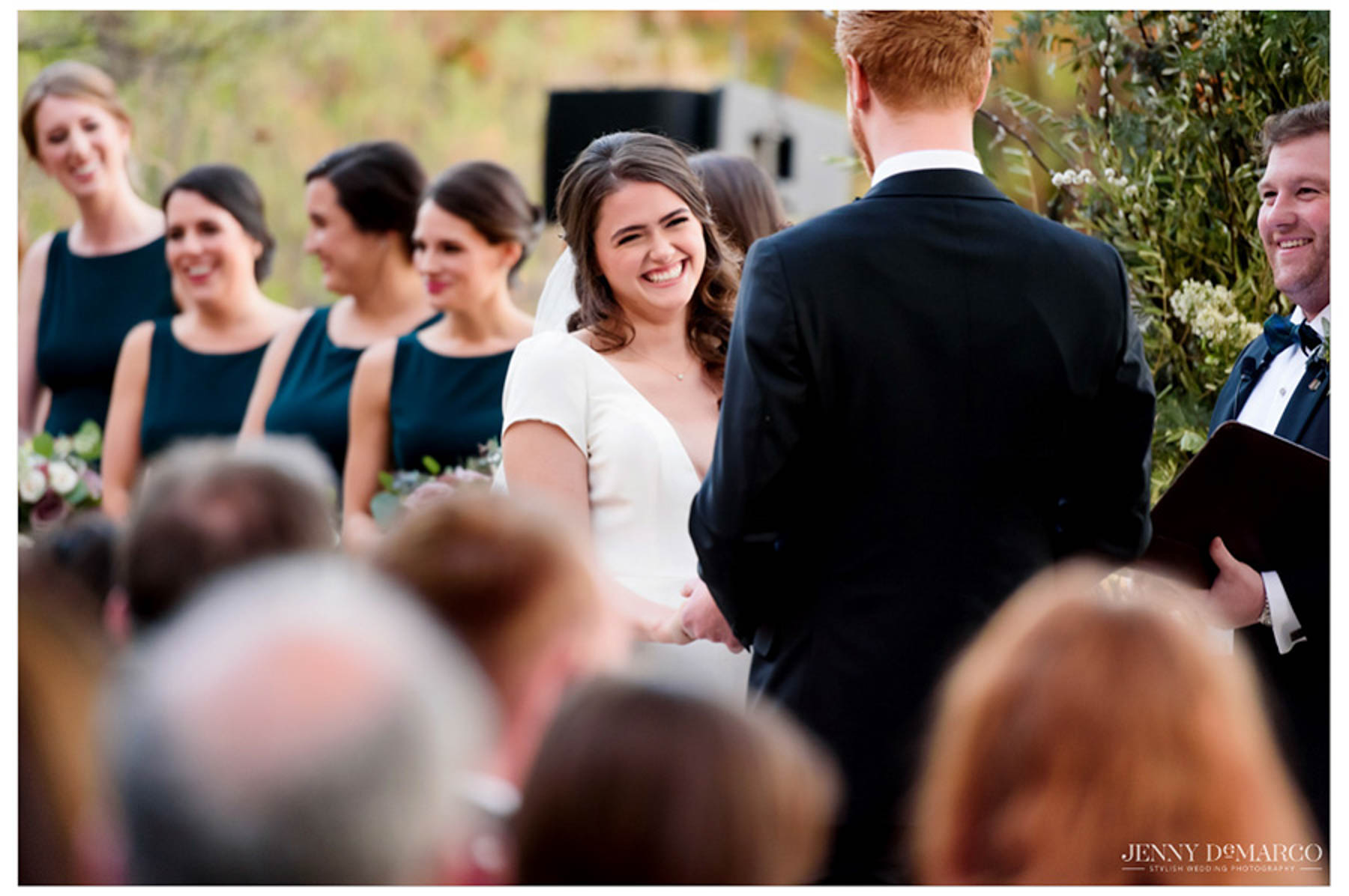 bride laughs and looks at groom during ceremony